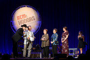 (L-R) Jon Pardi, Herb Graham, Garneta Johnston, Bobbie Hedrick and Pam Miller speak onstage during the 12th Annual ACM Honors at Ryman Auditorium on August 22, 2018 in Nashville, Tennessee.