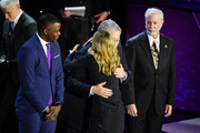 Kelly Ripa hugs Everyday Hero Dr. Jeff Cohen onstage during the 12th Annual CNN Heroes: An All-Star Tribute  at American Museum of Natural History on December 9, 2018 in New York City.