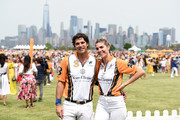 Nacho Figueras (L) and Delfina Blaquier attend the 12th Annual Veuve Clicquot Polo Classic at Liberty State Park on June 01, 2019 in Jersey City, New Jersey.
