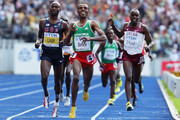 (L-R) Bernard Lagat of United States, Kenenisa Bekele of Ethiopia and James Kwalia C'Kurui of Qatar cross the line in the men's 5000 Metres Final during day nine of the 12th IAAF World Athletics Championships at the Olympic Stadium on August 23, 2009 in Berlin, Germany.