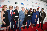 Ellie Woodruff, Dave Woodruff, Steven Schulz, Israel Del Toro, Sheryl Crow, Kionte Storey, Anna Marie Dougherty, Bob Woodruff, and Hasan Minhaj attend the 13th annual Stand Up for Heroes to benefit the Bob Woodruff Foundation at The Hulu Theater at Madison Square Garden on November 04, 2019 in New York City.