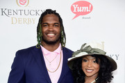 Football player Lorenzo Mauldin (L) attends the 142nd Kentucky Derby at Churchill Downs on May 07, 2016 in Louisville, Kentucky.