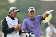 Justin Rose of England waits on the 5th hole with caddie MArk Fulcher during the third round of The 143rd Open Championship at Royal Liverpool on July 19, 2014 in Hoylake, England.