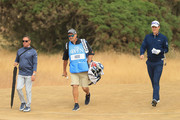 Justin Rose of England (R) with his caddie Mark Fulcher (C) and coach Sean Foley on the 12th hole during previews to the 147th Open Championship at Carnoustie Golf Club on July 18, 2018 in Carnoustie, Scotland.
