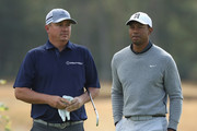 Tiger Woods of the United States (R) and Jason Dufner of the United States during previews to the 147th Open Championship at Carnoustie Golf Club on July 18, 2018 in Carnoustie, Scotland.