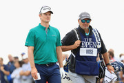 Justin Rose of England with his caddie Mark Fulcher on the 16th hole during the first round of the 147th Open Championship at Carnoustie Golf Club on July 19, 2018 in Carnoustie, Scotland.