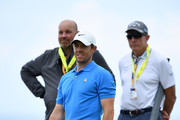 Rory McIlroy of Northern Ireland, Thomas Bjorn of Denmark and David Leadbetter look on during a practice round prior to the 148th Open Championship held on the Dunluce Links at Royal Portrush Golf Club on July 16, 2019 in Portrush, United Kingdom.