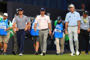 Justin Thomas of the United States, Kevin Kisner of the United States and Jim Furyk of the United States walk during a practice round prior to the 148th Open Championship held on the Dunluce Links at Royal Portrush Golf Club on July 16, 2019 in Portrush, United Kingdom.