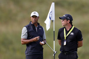 Tiger Woods of the United States and putting coach Matt Killen look on during a practice round prior to the 148th Open Championship held on the Dunluce Links at Royal Portrush Golf Club on July 16, 2019 in Portrush, United Kingdom.