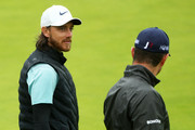 Tommy Fleetwood of England talks to Justin Rose of England during a practice round prior to the 148th Open Championship held on the Dunluce Links at Royal Portrush Golf Club on July 17, 2019 in Portrush, United Kingdom.