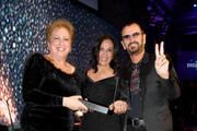 (L-R) Caryl M. Stern, Olivia Harrison, and Sir Ringo Starr attend the 14th Annual UNICEF Snowflake Ball 2018 on November 27, 2018 in New York City.