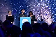 Caryl M. Stern, Honoree Sir Ringo Starr, and Olivia Harrison onstage at the 14th Annual UNICEF Snowflake Ball 2018 on November 27, 2018 in New York City.