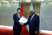 General Secretary of the Communist Party of China and the President of the People's Republic of China Xi Jinping (L) receives the The IAAF Golden Order of Merit from outgoing president of the IAAF Lamine Diack during day one of the 15th IAAF World Athletics Championships Beijing 2015 at Beijing National Stadium on August 22, 2015 in Beijing, China.