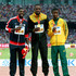 Justin Gatlin Usain Bolt Photos - (L-R) Silver medalist Justin Gatlin of the United States, gold medalist Usain Bolt of Jamaica and bronze medalist Anaso Jobodwana of South Africa pose on the podium during the medal ceremony for the Men's 200 metres final during day seven of the 15th IAAF World Athletics Championships Beijing 2015 at Beijing National Stadium on August 28, 2015 in Beijing, China. - 15th IAAF World Athletics Championships Beijing 2015 - Day Seven