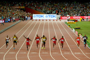 Usain Bolt of Jamaica (C) wins gold ahead of (L-R) Andre De Grasse of Canada, Asafa Powell of Jamaica, Justin Gatlin of the United States, Tyson Gay of the United States, Mike Rodgers of the United States, Trayvon Bromell of the United States, Bingtian Su of China and Jimmy Vicaut of France cross the finish line in the Men's 100 metres final during day two of the 15th IAAF World Athletics Championships Beijing 2015 at Beijing National Stadium on August 23, 2015 in Beijing, China.