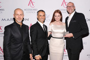 (L-R)  Italo Zucchelli, Francisco Costa, Julianne Moore, and Ulrich Grimm attend the 16th Annual ACE Awards presented by the Accessories Council at Cipriani 42nd Street on November 5, 2012 in New York City.