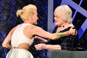 Winner of the award for Excellence in Costume Design for Fantasy Film, The Hunger Games: Catching Fire, Trish Summerville (L) accepts the award from actress June Squibb onstage during the 16th Costume Designers Guild Awards with presenting sponsor Lacoste at The Beverly Hilton Hotel on February 22, 2014 in Beverly Hills, California.