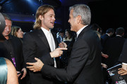 Actors Brad Pitt and George Clooney attend the 17th Annual Critics' Choice Movie Awards held at The Hollywood Palladium on January 12, 2012 in Los Angeles, California.