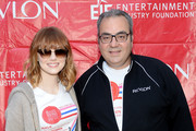Actress Emma Stone and  Chief Executive Officer and President of Revlon Lorenzo Delpani attend the 17th Annual EIF Revlon Run Walk For Women on May 3, 2014 in New York City.