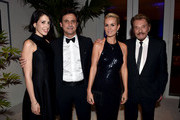 (L-R) Coco Pierrel, President and Chief Executive Officer for Lacoste North America Francis Pierrel, actress Laeticia Hallyday and singer Johnny Hallyday attend the 17th Costume Designers Guild Awards with presenting sponsor Lacoste at The Beverly Hilton Hotel on February 17, 2015 in Beverly Hills, California.