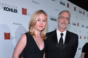 Actress Julia Stiles and director Jon Avnet arrive to the 18th Annual Art Directors Guild Exellence In Production Design Awards at The Beverly Hilton Hotel on February 8, 2014 in Beverly Hills, California.