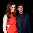 He poses for pictures with Ashley Greene.