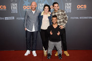 Franck Gastambide (L), Sabrina Ouazani (2-L), Anouar Toubali (2-R) and Malik Bentalha attend the closing ceremony of the 18th L'Alpe D'Huez International Comedy Film Festival on January 16, 2016 in Alpe d'Huez, France.