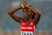 Ayanna Alexander of Trinidad and Tobago reacts as she wins silver in the women's triple jump during day five of the Delhi 2010 Commonwealth Games at the Jawaharlal Nehru Stadium on October 8, 2010 in Delhi, India.