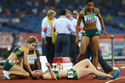 Pirrenee Steinert (L) and Jody Henry (R) of Australia help team mate Sally Pearson from the track after she broke down following the women's 4 x 400 metres relay final at Jawaharlal Nehru Stadium during day nine of the Delhi 2010 Commonwealth Games on October 12, 2010 in Delhi, India.