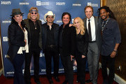 (L-R) Christiev Carothers, Big Kenny of Big & Rich, musical artist Brad Paisley, President and CEO of the Big Machine Label Group Scott Borchetta, Senior Vice President of Creative at Big Machine Label Group Sandi Spika Borchetta, comedian Kevin Nealon, and musical artist Paul Beaubrun attend the 1st Annual Nashville Shines for Haiti concert benefiting J/P Haitian Relief Organization - Day 2 hosted by Johnathon Arndt and Newman Arndt on April 27, 2016 in Nashville, Tennessee.