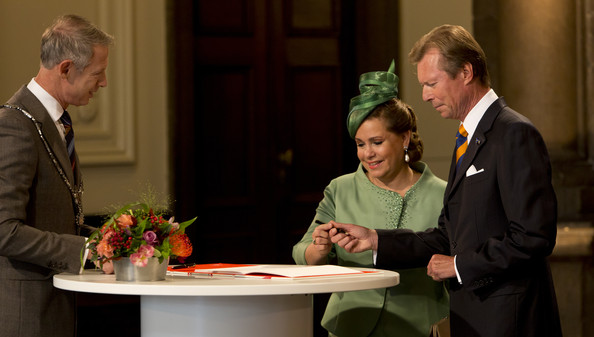 Grand Duchess Maria Teresa of Luxembourg and Grand Duke Henri of Luxembourg sign the guest book in the city hall, watched by  as they attends celebrations marking the 200th anniversary of the kingdom of The Netherlands on August 30, 2014 in Maastricht, The Netherlands.
