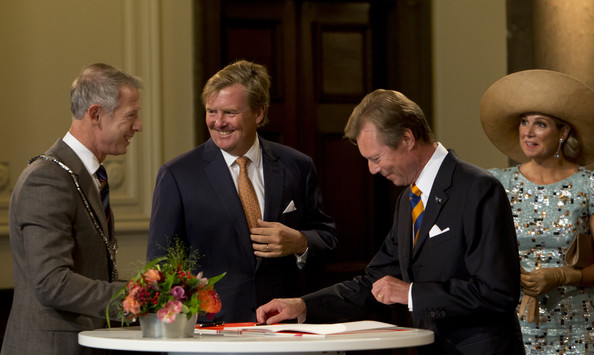 King Willem-Alexander of The Netherlands and Queen Maxima of The Netherlands watch as Grand Duke Henri of Luxembourg signs the guest book in the city hall, watched by  as they attends celebrations marking the 200th anniversary of the kingdom of The Netherlands on August 30, 2014 in Maastricht, The Netherlands.