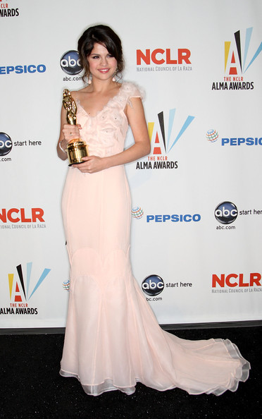 Selena Gomez Actress Selena Gomez poses in the press room with the Year in Televison Comedy Actress award for