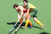 Glenn Turner of Australia is challenged by Wouter Jolie of the Netherlands during the match between Australia and the Netherlands on day two of the 2009 Hockey Champions Trophy at the State Netball and Hockey Centre on November 29, 2009 in Melbourne, Australia.