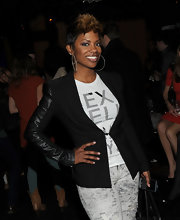 Kandi's oversized hoop earrings add some energy and excitement to her look.  These earrings feature encrusted diamonds.