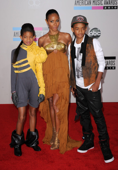 Actress Jada Pinkett Smith (C) with her children Willow Smith (L) and Jaden Smith arrive at the 2010 American Music Awards held at Nokia Theatre L.A. Live on November 21, 2010 in Los Angeles, California.