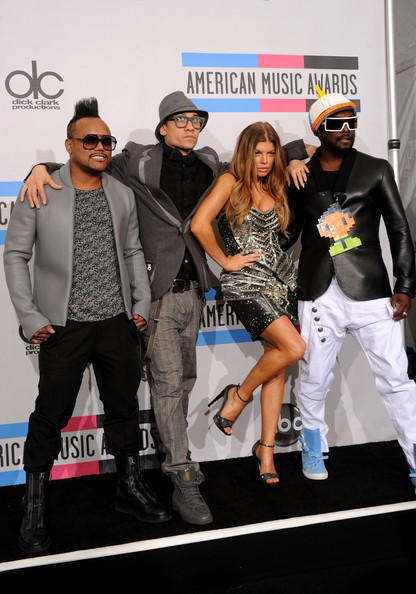 (L-R) apl de ap, will.i.am, Fergie, and Taboo from the musical group Black Eyed Pea, Winners of the Pop/Rock Music - Favorite Band, Duo or Group, pose  in the press room during the 2010 American Music Awards held at Nokia Theatre L.A. Live on November 21, 2010 in Los Angeles, California.