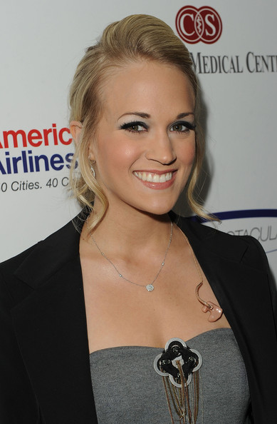 Carrie Underwood Singer Carrie Underwood poses backstage at the 25th Anniversary Of Cedars-Sinai Sports Spectacular held at the Hyatt Regency Century Plaza Hotel on May 23, 2010 in Los Angeles, California.