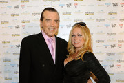 Actor Chazz Palminteri (L) and his wife Gianna Palminteri arrive at the 2010 Miss Universe Pageant at the Mandalay Bay Events Center August 23, 2010 in Las Vegas, Nevada.