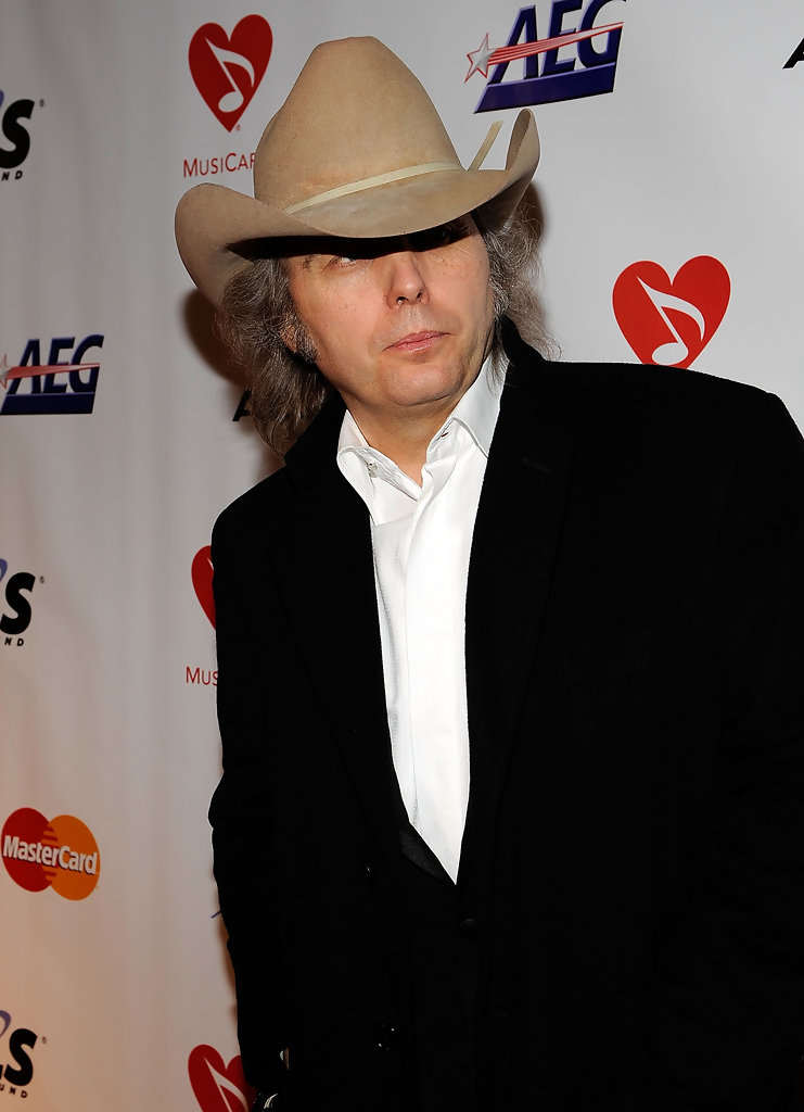 Since the start of his music career Dwight Yoakam has proven hes more than just another guy with a guitar and a hat He has risen from hot country star to being one of country musics biggest influences