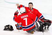 Goalkeeper Roger Johansen #1 of Norway celebrates with the game-winning goal scorer Eskil Hagen #7 after their 2-1 win over Canada during the Ice Sledge Hockey Bronze Medal Game between Norway and Canada on day eight of the 2010 Vancouver Winter Paralympic Games at UBC Thunderbird Arena on March 19, 2010 in Vancouver, Canada.