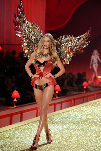 Model Rosie Huntington-Whiteley walks the runway during the 2010 Victoria's Secret Fashion Show at the Lexington Avenue Armory on November 10, 2010 in New York City.