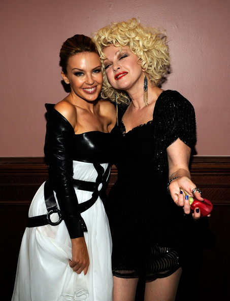 Cyndi Lauper (EXCLUSIVE COVERAGE PREMIUM RATES APPLY) Singers Kylie Minogue (L) and Cyndi Lauper attend the 2010 amfAR New York Inspiration Gala at The New York Public Library on June 3, 2010 in New York, New York.