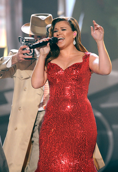 Singer Kelly Clarkson performs onstage at the 2011 American Music Awards held at Nokia Theatre L.A. LIVE on November 20, 2011 in Los Angeles, California.