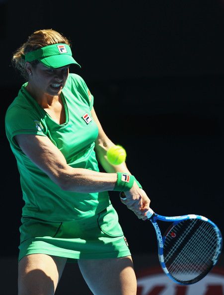 Kim Clijsters of Belgium plays a backhand in her second round match against Carla Suarez Navarro of Spain during day four of the 2011 Australian Open at Melbourne Park on January 20, 2011 in Melbourne, Australia.