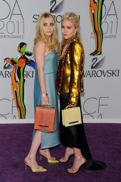 Designers Ashley Olsen (L) and Mary-Kate Olsen attend the 2011 CFDA Fashion Awards at Alice Tully Hall, Lincoln Center on June 6, 2011 in New York City.