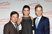 Michael J. Fox, Julianna Margulies and Matt Czuchry attend the 2011 A Funny Thing Happened On The Way To Cure Parkinson's event at The Waldorf=Astoria on November 12, 2011 in New York City.