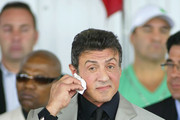 Sylvester Stallone wipes his face during the 2011 International Boxing Hall of Fame Inductions at the International Boxing Hall of Fame   on June 12, 2011 in Canastota, New York. Stallone is a 2011 inductee.