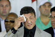 Sylvester Stallone wipes his brow during the 2011 International Boxing Hall of Fame Inductions at the International Boxing Hall of Fame   on June 12, 2011 in Canastota, New York. Stallone is a 2011 inductee.