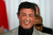 Sylvester Stallone laughs after being inducted into the International Boxing Hall of Fame at the International Boxing Hall of Fame on June 12, 2011 in Canastota, New York.